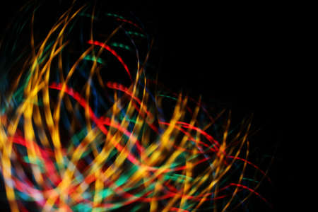 holiday glowing ribbons of light in the dark Stock Photo