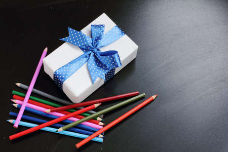 festively: a set of pencils and festively wrapped gift