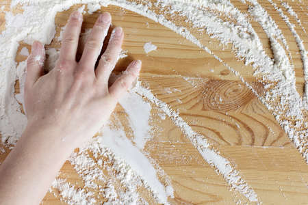 chand cook sweeps aside the remnants of flour