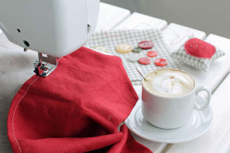 invigorating hot coffee with milk on a sewing background