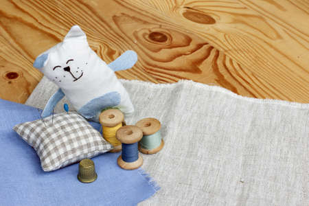 needlework: soft cloth cat with needlework and embroidery items