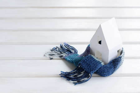 warm home: environmentally friendly warm home wrapped in a soft comfortable scarf