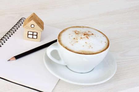 housing lot: coffee with milk foam and cinnamon flavored at the beginning of the working day Stock Photo