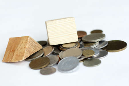 ruined house: the concept of a ruined house on a pile of coins invested in construction
