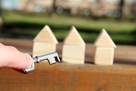 a symbolic key to the background of small wooden houses