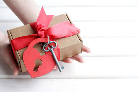 dedicate: a person receives a gift or presents with a hint Stock Photo