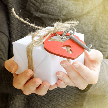 dedicate: retro gift tied with a hanging heart-lock and key-unusual