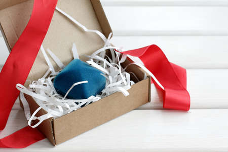 closed ribbon: unpacked packaging of the gift in the blue box Stock Photo
