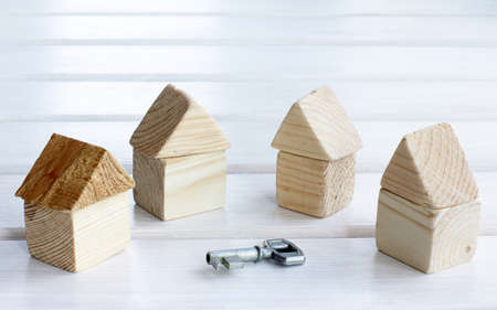 ownership and control: options for the set of houses and a symbolic key Stock Photo