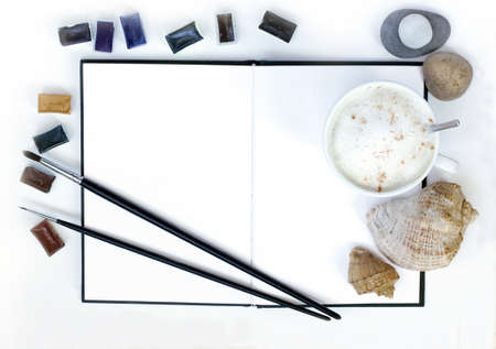 frothy: inspiration object frothy coffee, notebook, paint, sea stones and seashells, flat lay, top view