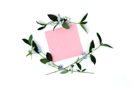congratulatory: background with spring flowers as a frame and blank sheet for congratulations top view spring congratulatory card Stock Photo