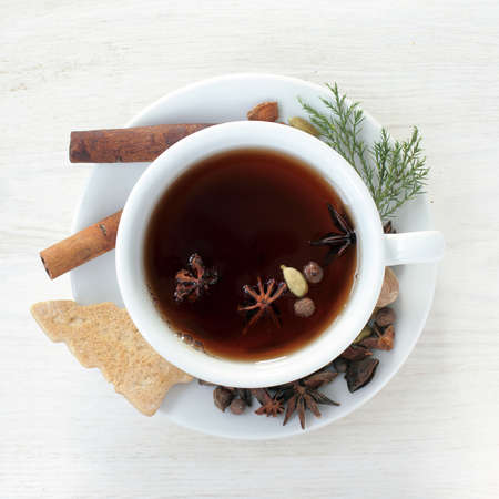 tea in a festive Christmas atmosphere, with ginger and spices tree top view  festive flavored tea