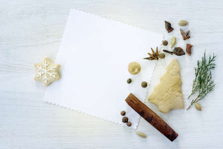 flat lay festive background with Christmas tree and gingerbread star, and various spices top view  fragrant greeting Christmas fantasy