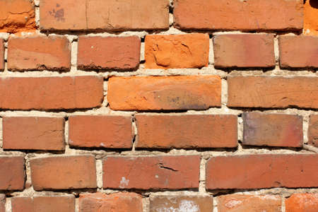 oldness: very old red bricks in the oldness of the masonry of the old house  red brick wall