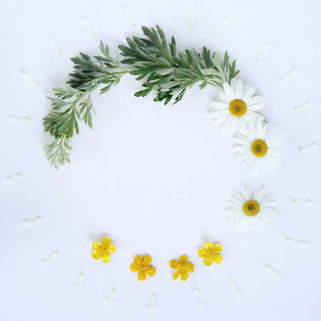 Round floral frame with wild flowers top view  floral frame