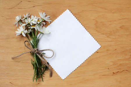 festive bouquet of daisies and a card for inscriptions top view  summer wildflowers Stock Photo