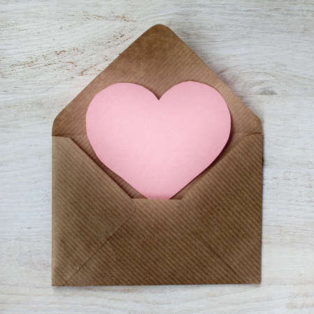 mail a message in the form of heart peeps out of an envelope  letter of love