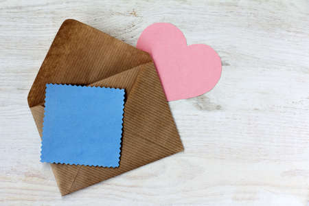 mail a message in the form of heart and a card for messages peeps out of an envelope  romantic love letter