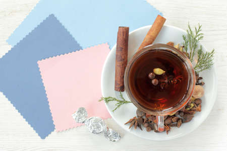flat layout with tea decorated with different aromatic spices top view  tea flavored with candy