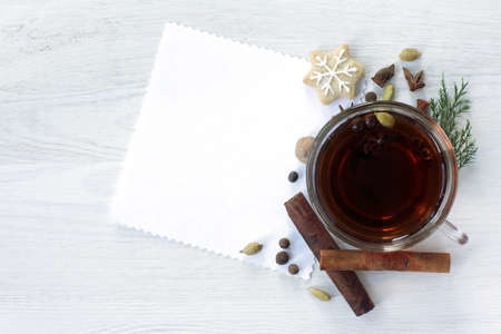 festive background with black tea decorated with fragrant spices and ginger cookies in the form of a Christmas Star top view  Christmas fragrant tea Stock Photo