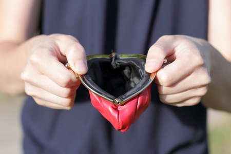 man with open and empty red wallet in the hands  empty purse with no money Stock Photo