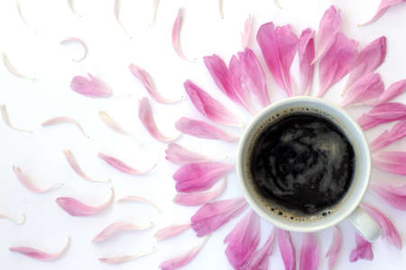 flat lay with white cup of black coffee surrounded pink petals top view  black coffee with the scent of flowers