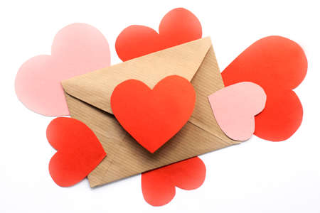 concept of mail envelope from which messages are emitted in the form of hearts on top of the form  expression of love in a letter Stock Photo