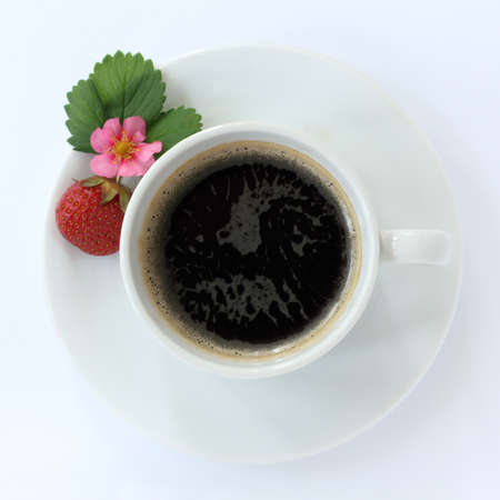 Black coffee with strawberries on a light background top view  strawberry aroma for real coffee Stock Photo