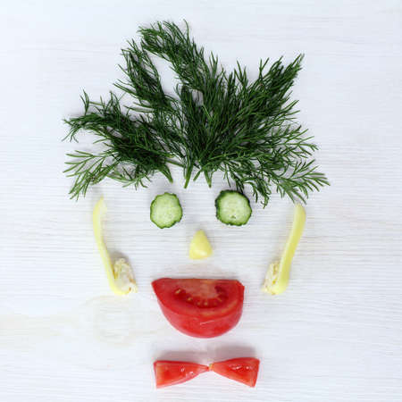 hilarious: flat layout cheerful human face from different vegetables, top view  hilarious vegetarian avatar