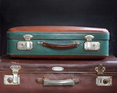 stow: Two suitcases on a dark background  luggage time-tested