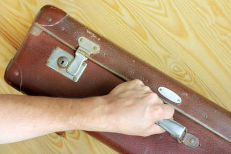 stow: shabby brown vintage suitcase in hand  time to cruise retro