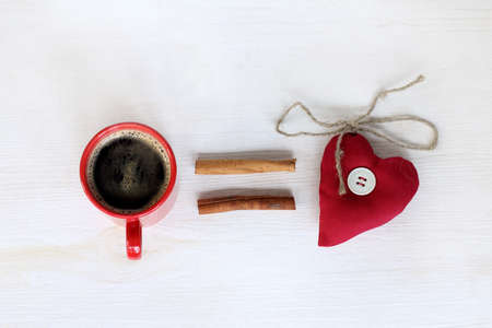 natural black coffee with cinnamon sticks aromatic and heart symbol  coffee equals love