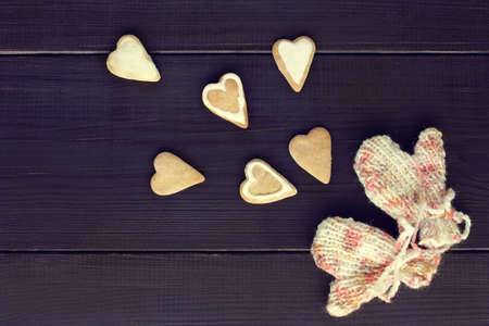 warmest: flat layout figured cookies, heart-shaped and knitted mittens top view  share warmest feelings