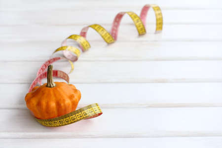 fruit zucchini wrapped around a flexible ruler to measure  idea moderate vegetable diet