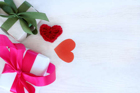 couple holiday gifts next to two valentines on a light table top view  declaration of love with a surprise Stock Photo