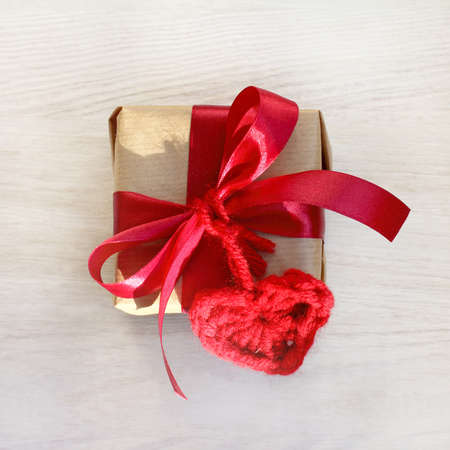 holiday decorations gift with heart symbol made by hand top view  surprise for Valentine Day Stock Photo