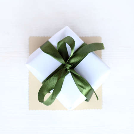 gift tied up by green ribbon with a bow view from above  most festive subject Stock Photo