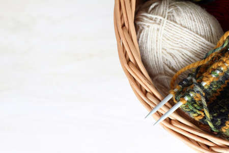 warm things: wicker basket thread for knitting top view  warm things own hands Stock Photo
