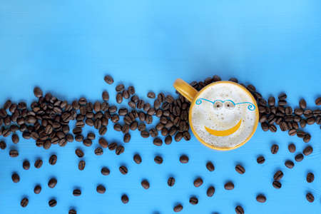 cappuccino cheerful concept with glasses on a blue table among roasted top view  coffee smiling Stock Photo