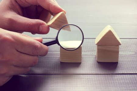 viewing in a magnifying glass the design of a house layout  inspection of construction objects Stock Photo
