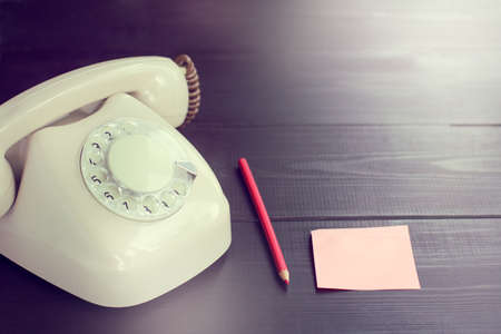 analog retro phone, pencil and blank sheet  waiting for an important call Stock Photo