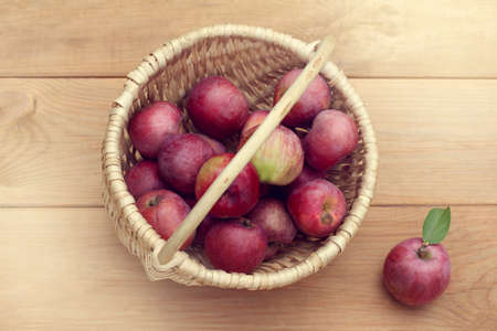 full wicker basket of ripe apples top view  harvest of autumn fruits