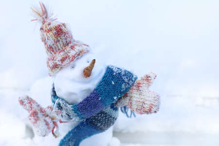 Christmas snowman in scarf, hat and mittens  warming smile winter holidays