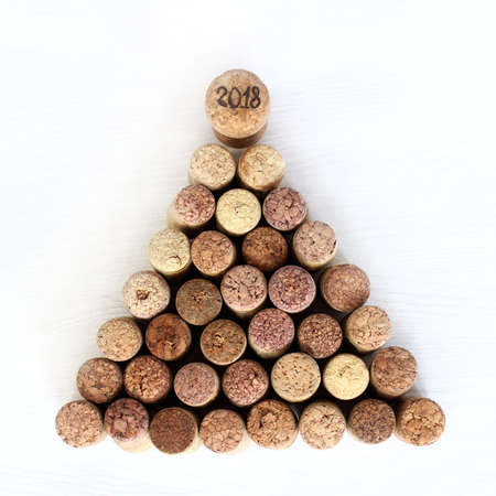 festive Christmas tree made of wine stoppers with a top decorated with a cork with a number idea New Year tree 2018
