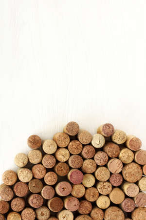 flat layout of wine corks of different varieties on a light wooden background top view  mountain open  flavors Stock Photo
