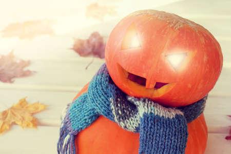 festively dressed in blue scarf cheerful pumpkin autumn snowman-pumpman