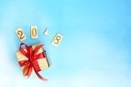 installation gift with red ribbon and wooden numbers with a Christmas tree top view holiday concept 2018