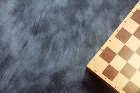 old wooden chess board on a measured coated surface top view  game truce