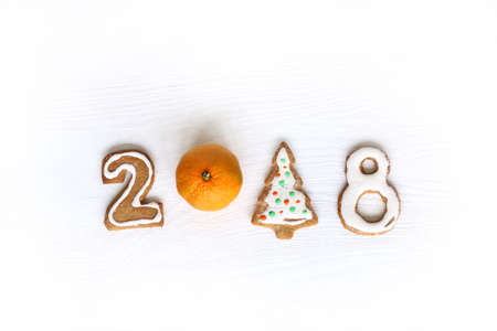 installation with figured ginger biscuits and mandarin  Christmas concept 2018   Stock Photo