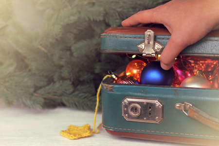 hand opens a suitcase with holiday treasure